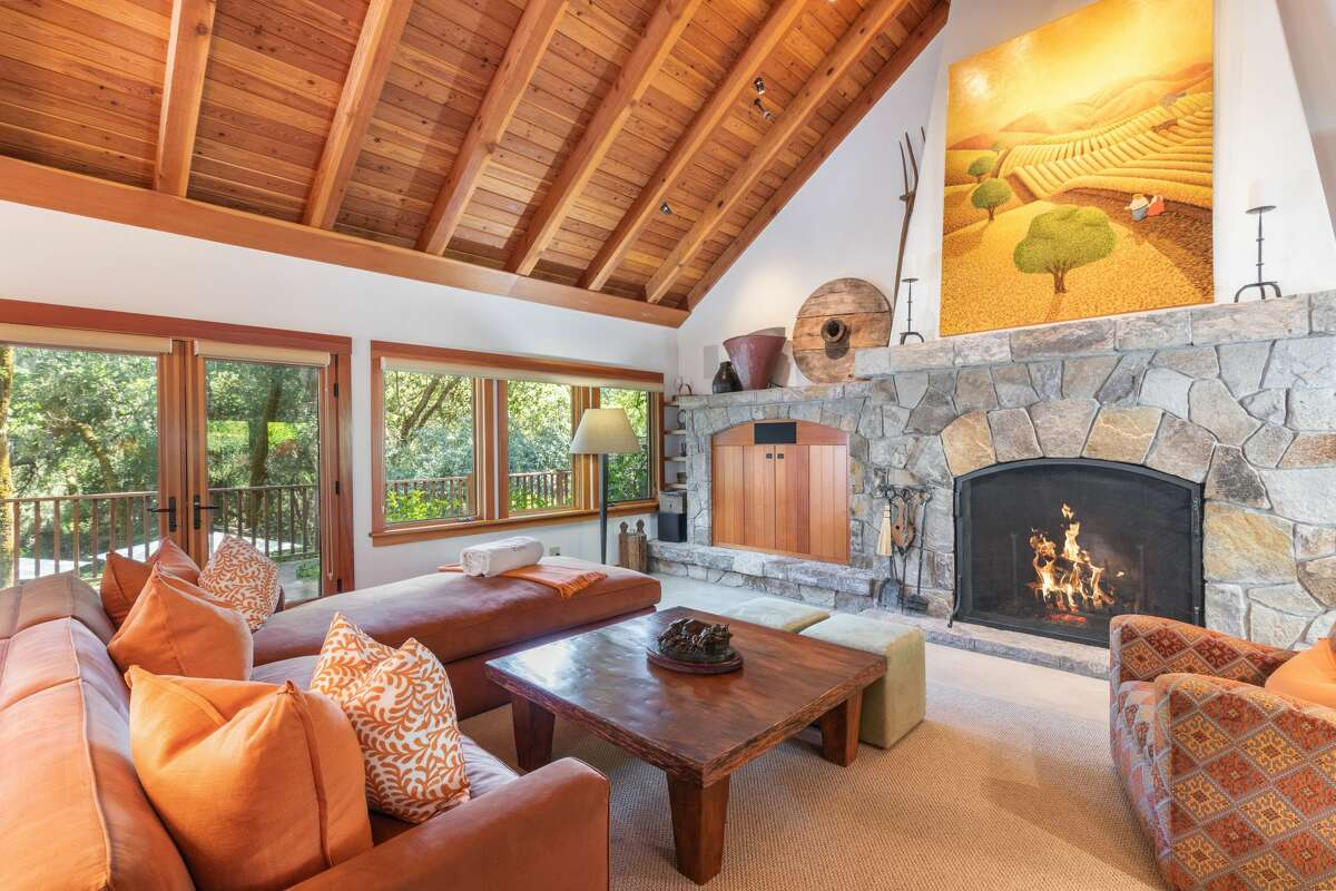 Inside the home, this is one of two Rumford fireplaces that warm the interior's generous space.