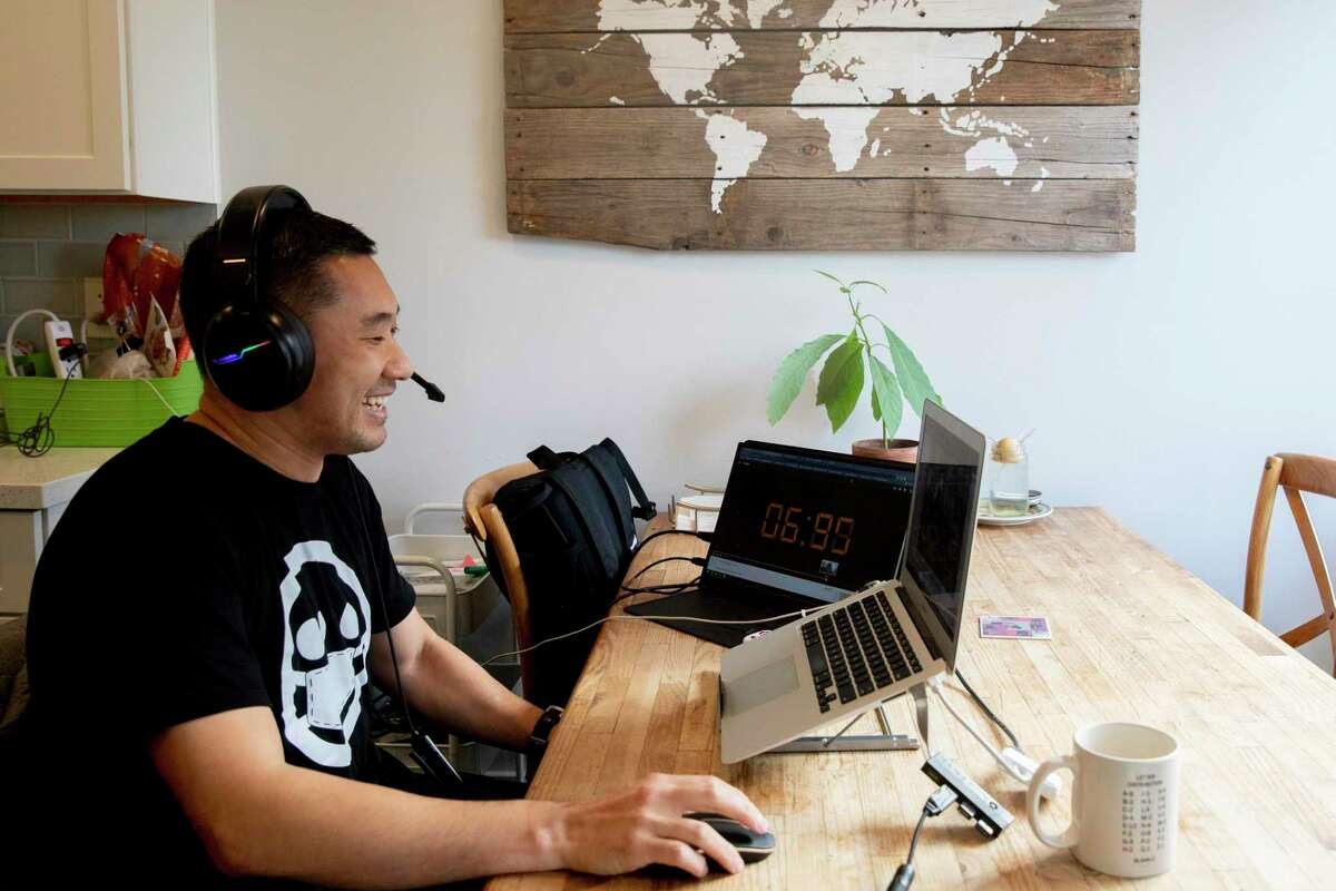 Raymond Lie conducts a virtual class with his eighth grade social studies class while working from his home in Oakland, Calif., on Friday, January 8.