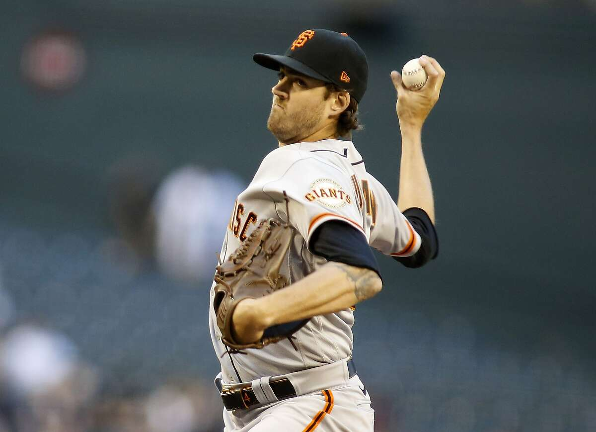San Francisco Giants' Kevin Gausman delivers a pitch against the Arizona Diamondbacks during the first inning of a baseball game Monday, May 25, 2021, in Phoenix. (AP Photo/Darryl Webb)