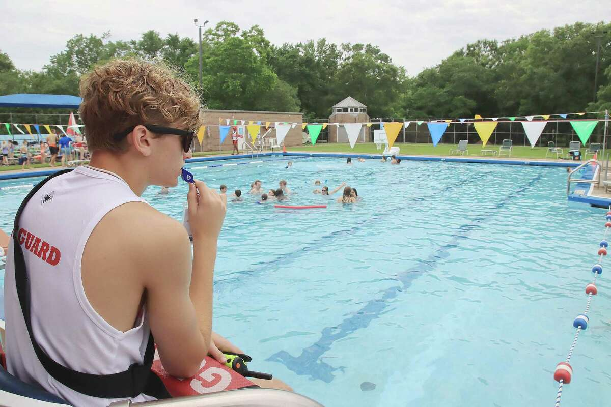 Lifeguard Logan Fischer watches over swimmers at Friendswood City Pool. Pool staff will still conduct regular cleaning of common areas and undergo temperature checks at each shift to ensure safety and minimize risk.