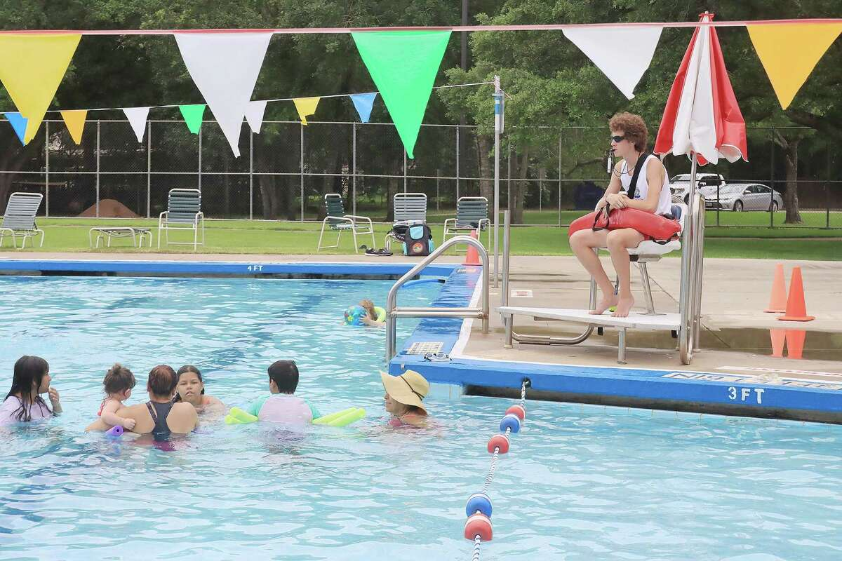 Lifeguard Zach Otto keeps watch over people using the Friendswood City Pool. The pool will be open at full capacity - 235 people - and with no rules or restrictions related to COVID-19.