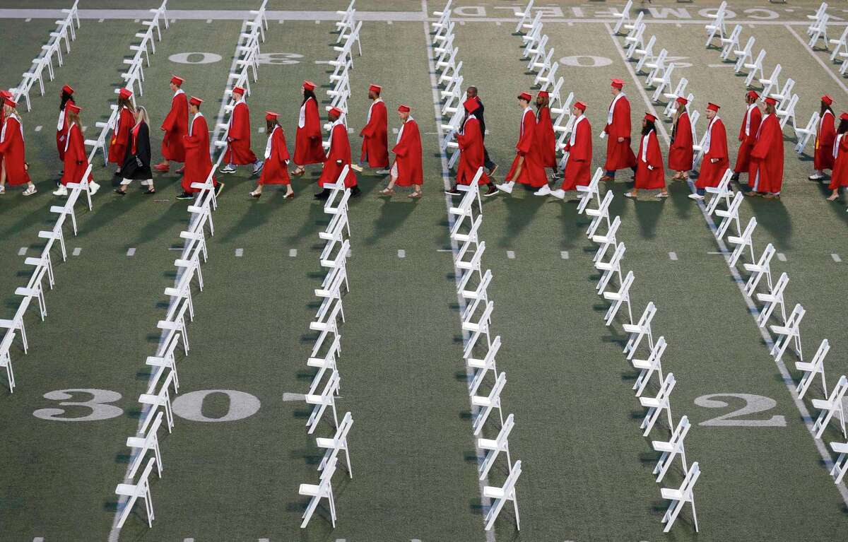 Atascocita students enter Turner Stadium for a graduation ceremony, Tuesday, June 1, 2021, in Humble.