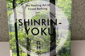"""""""Shinrin-Yoku: the Healing Art of Forest Bathing"""" by Oliver Luke Delorie promotes the practice of slowly enjoying a walk through the woods to improve one's health. Studies have shown that connecting with nature can impact stress levels and blood pressure. (Courtesy photo)"""