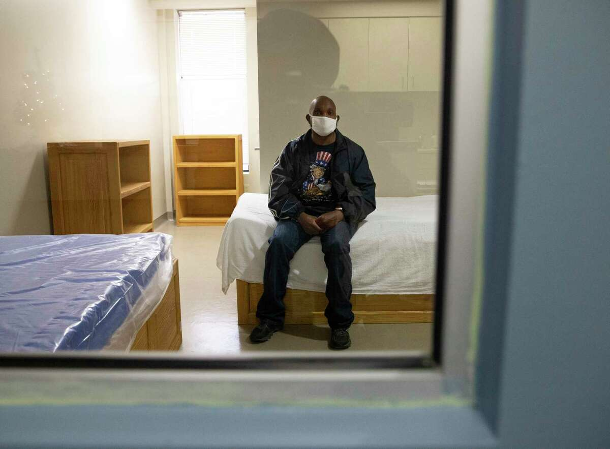 A patient at the Judge Ed Emmett Harris County Mental Health Diversion Center in Houston poses for a photograph in a room in December 2020. The center opened in fall 2018 as a way to connect mentally ill individuals to services rather than jail. As of Jan. 31, 2021, there have been about 3,500 diversions to the center.
