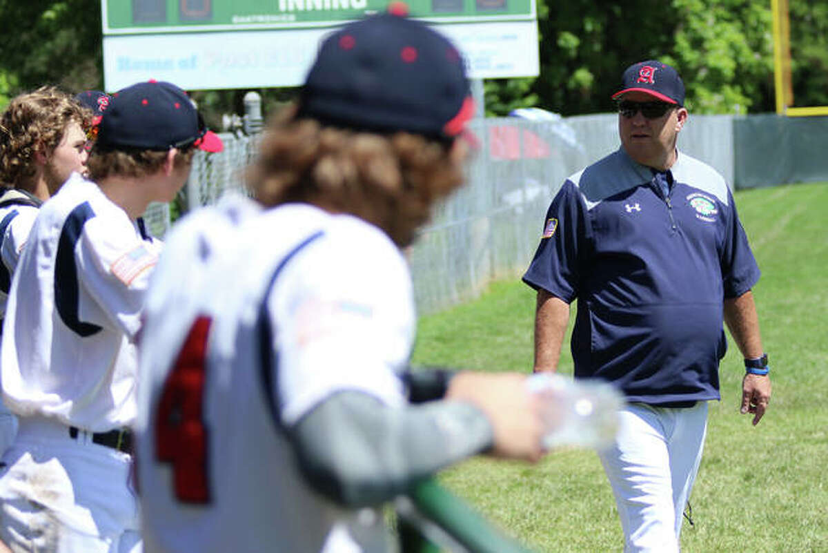 Alton American Legion baseball team manager Doug Booten (right) chats with players in the dugout during a 2020 game in Washington, Mo. Alton is scheduled to open its summer season this weekend at the Baseball Battles Cancer Tournament in Ballwin, Mo.