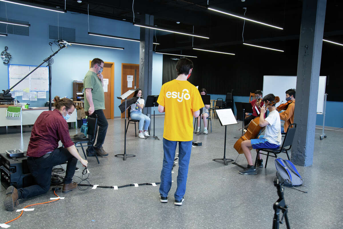 """Youth composer Matthew Kenyon leads a rehearsal for his piece """"Fort Orange Station"""" as the musicians prepare for their recording session the next day. The piece marks the end of the soundwalk."""