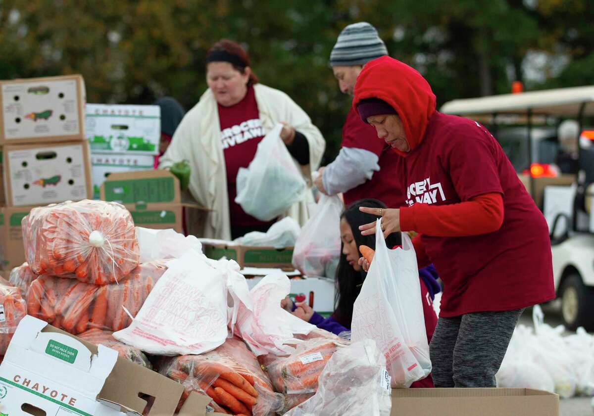 """More than 800 volunteers helped give away more than 263,000 meals to local residents in need during The Ark Church's annual grocery giveaway, Saturday, Nov. 23, 2019, in Conroe. The church plans to celebrate 25 years with """"25 Days of Blessing"""" for the community."""