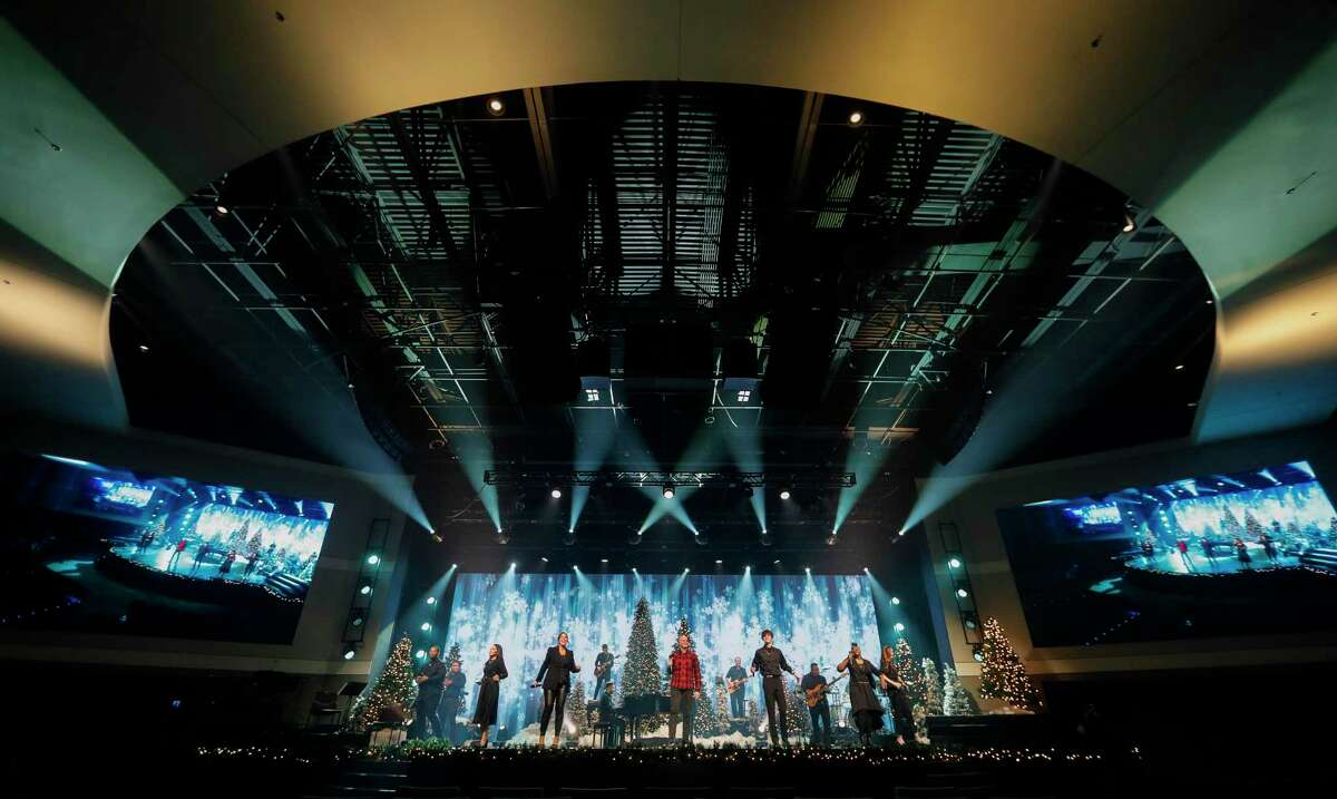 """More than 50 volunteers and staff members prepare four Christmas Eve services for both in-person and online worshipers, Wednesday, Dec. 22, 2020, in Conroe. The church plans to celebrate 25 years with """"25 Days of Blessing"""" for the community."""