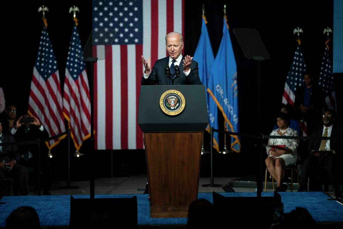 """President Joe Biden speaks as he commemorates the 100th anniversary of the Tulsa race massacre, at the Greenwood Cultural Center, Tuesday, June 1, 2021, in Tulsa, Okla. The Democrat has denounced a """"tireless assault"""" on the right to vote and vowed to """"fight like heck with every tool at my disposal"""" to pass federal legislation aimed at preventing states like Texas from restricting voting."""