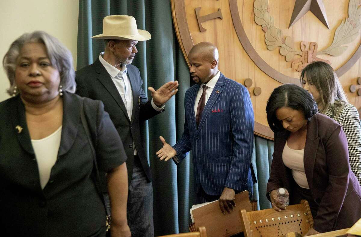 Gary Bledsoe, president of the Texas NAACP, left, shakes hands with State Rep. Ron Reynolds, D - Missouri City, after they spoke at a news conference against Senate Bill 7, known as the Election Integrity Protection Act, at the Capitol in Austin, Texas, on Sunday May 30, 2021.