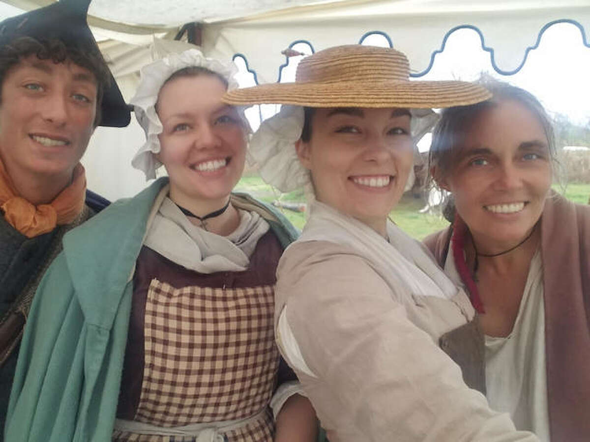 Pre-1840-style Mountain Man Rendezvous organizer and re-enactor Djuana Tucker is shown with her children at a recent rendezvous. The group's June 5-6 rendezvous is planned 10 a.m. to 5 p.m. at the Camp Dubois site, 198 N. Main St., in Wood River.
