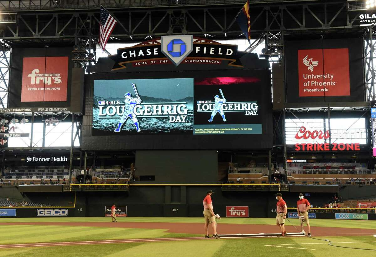 PHOENIX, ARIZONA - JUNE 02: Grounds crew prepare the field prior to a game between the Arizona Diamondbacks and New York Mets at Chase Field on June 02, 2021 in Phoenix, Arizona. MLB is hosting a new annual event, Lou Gehrig Day, to celebrate