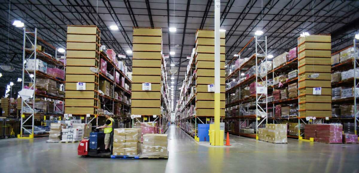 Amazon is rapidly growing its warehouses across the United States and in our region, with five new warehouses in the last two years. In the Capital region, an employee moves product around at the Amazon fulfillment center on Wednesday, June 2, 2021, in Schodack, N.Y. (Paul Buckowski/Times Union)
