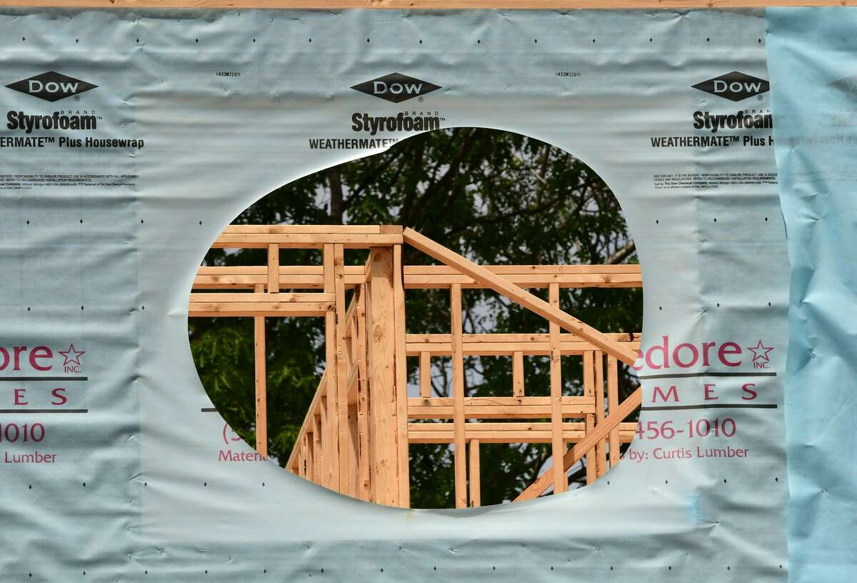 The framing of a home being built in the Harmon Grove development is seen through a wall on Wednesday, June 2, 2021 in Niskayuna, N.Y. Currently, there is a steep increase in lumber prices. (Lori Van Buren/Times Union)