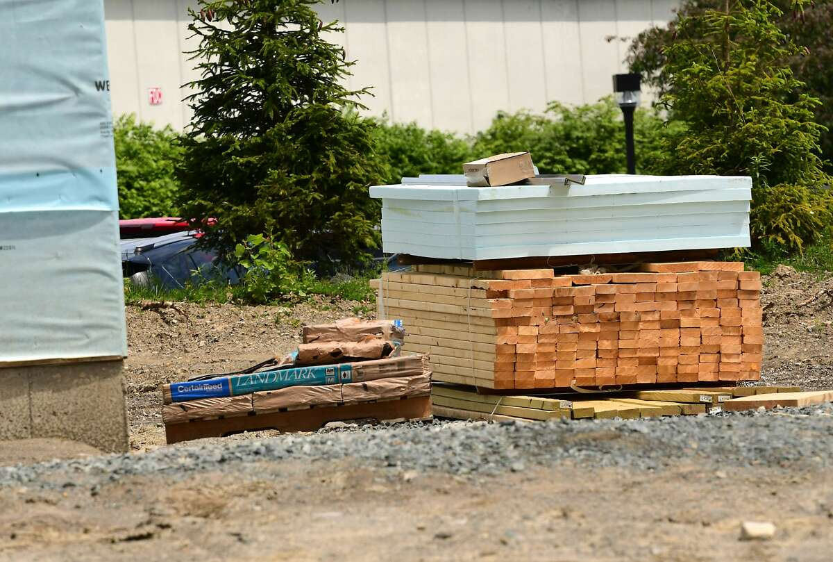 A stack of lumber is seen next to a home being built in the Harmon Grove development on Wednesday, June 2, 2021 in Niskayuna, N.Y. Currently, there is a steep increase in lumber prices. (Lori Van Buren/Times Union)