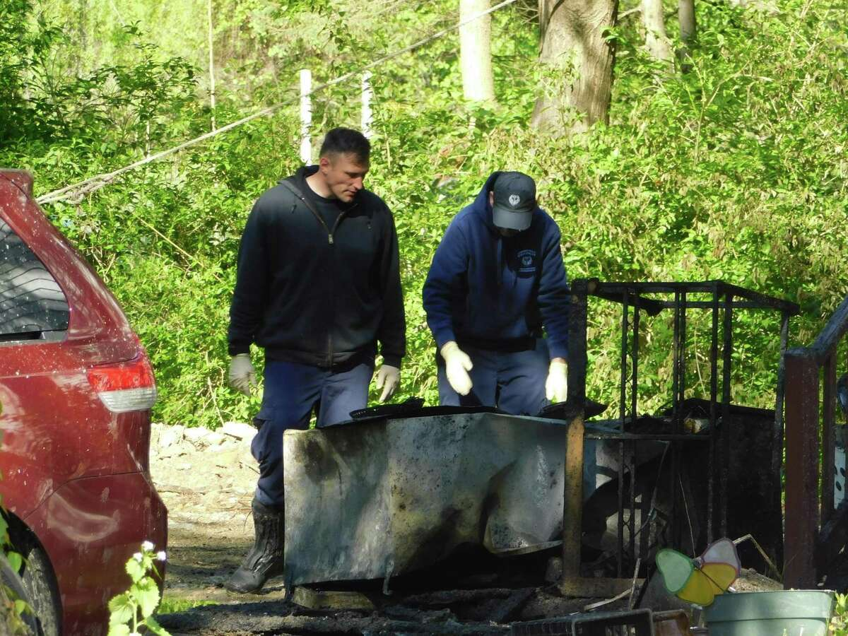 State Fire Marshal investigators working to determine the source and cause of a fire at 101 Housatonic Ave. in New Milford on May 16, 2019