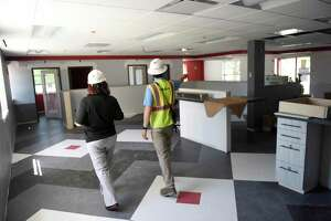 External Affairs Officer Desiree Ramos, left, and Project Superintendent James Thompson show the blood donation area of the renovated American Red Cross Greenwich Headquarters in Greenwich, Conn. Thursday, May 27, 2021. The facility, located at 99 Indian Field Road, is undergoing a major construction renovation project and has just surpassed $1 million in fundraising.