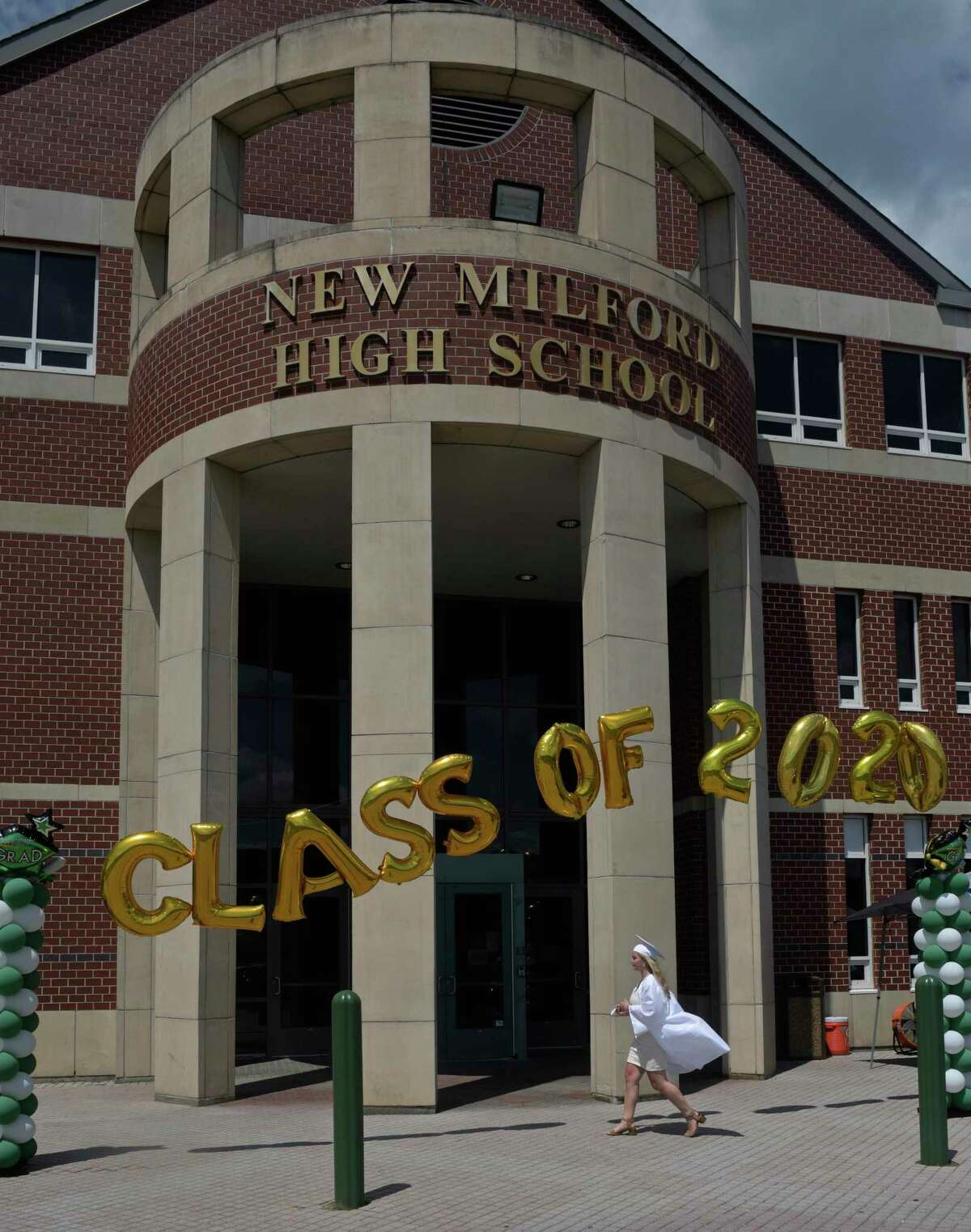 2020 New Milford High School graduates paraded to the high school from Sarah Noble Intermediate School and walked the sidewalk to receive their diplomas. Saturday, June 20, 2020, in New Milford, Conn.