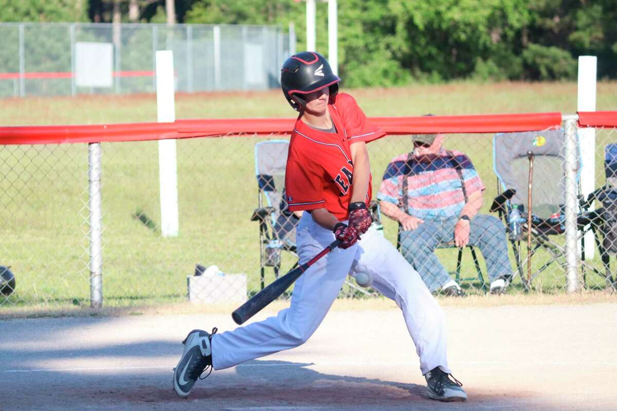 Jared Cook times up a pitch to drive for the Lakers against Mason County Eastern on June 1. (Robert Myers/News Advocate)