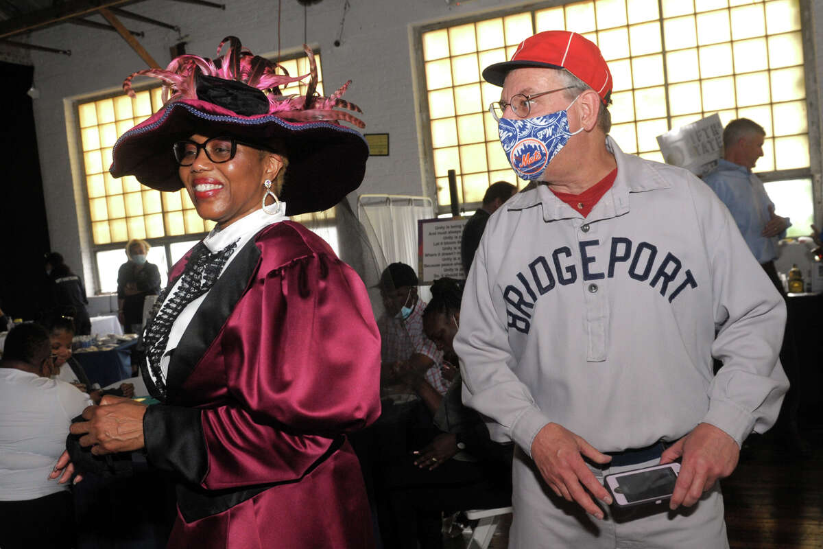 Dressed as two historic figures from Bridgeport's past, Deidre Johnson as Mary Freeman and Michael Bielawa as James O'Rourke attend a party at The Knowlton event venue kicking of a months-long celebration of the of Bridgeport's 200th anniversary, in Bridgeport, Conn. June 2, 2021. While officials and residents in the past have traditionally marked the founding of the city in 1836, the town that grew into Connecticut's largest municipality separated from neighboring Stratford in 1821.