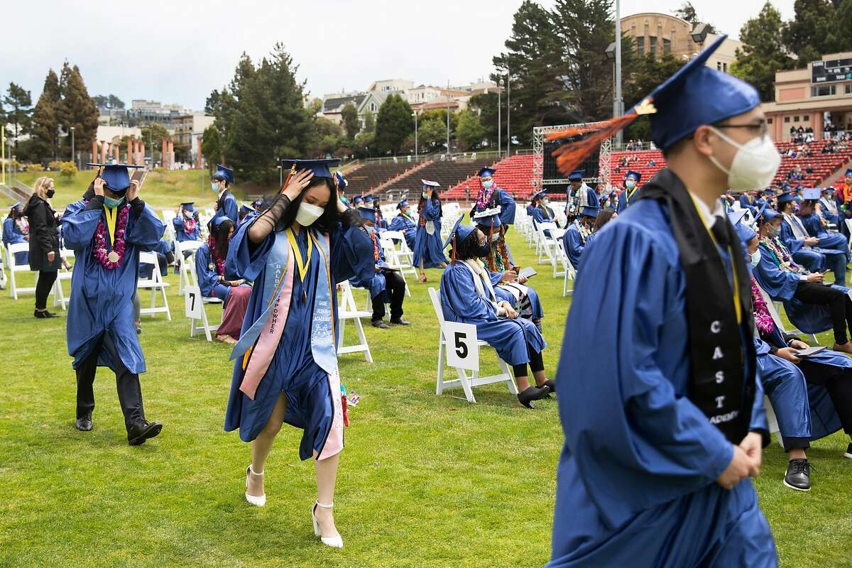 Students walk to the stage to receive their diplomas during Balboa High School's graduation ceremony at Kezar Stadium in San Francisco.