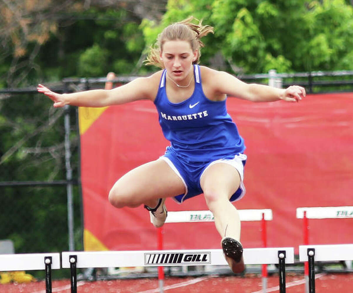 Marquette Catholic sophomore Sammy Hentrich clears the third to last hurdle in the 300-meter hurdles on Wednesday at the Althoff Class 1A Sectional in Belleville. Hentrich ran third in the race after qualifying for state in the long jump.