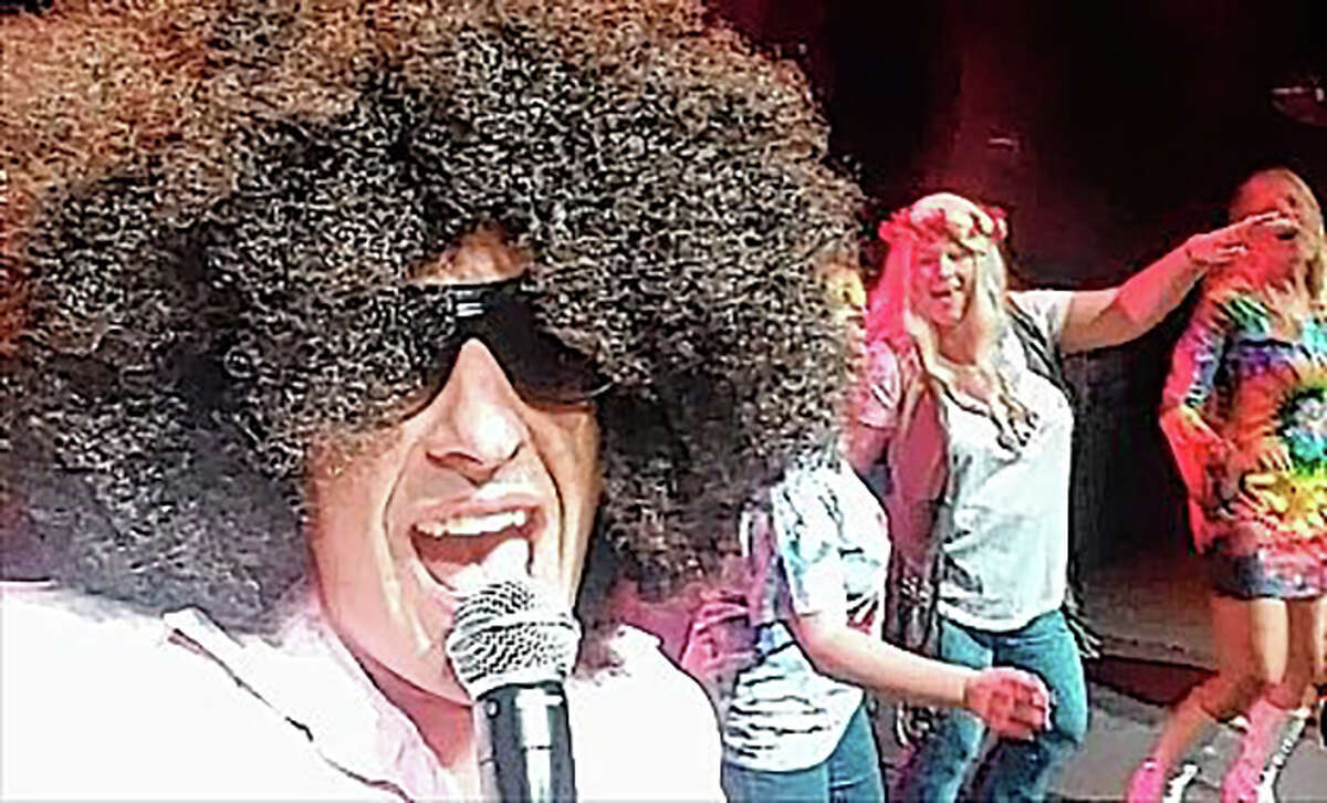 A member of Chicago-area disco cover band The Shagadelics performs during a show. The band's high-energy performance will kick off the Jacksonville Main Street Downtown Concert Series on Friday on the downtown square.