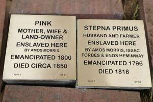Witness stones for former enslaved resident Stepna and Pink Primus outside the Pardee-Morris House in New Haven, Conn. on Wednesday, June 2, 2021.