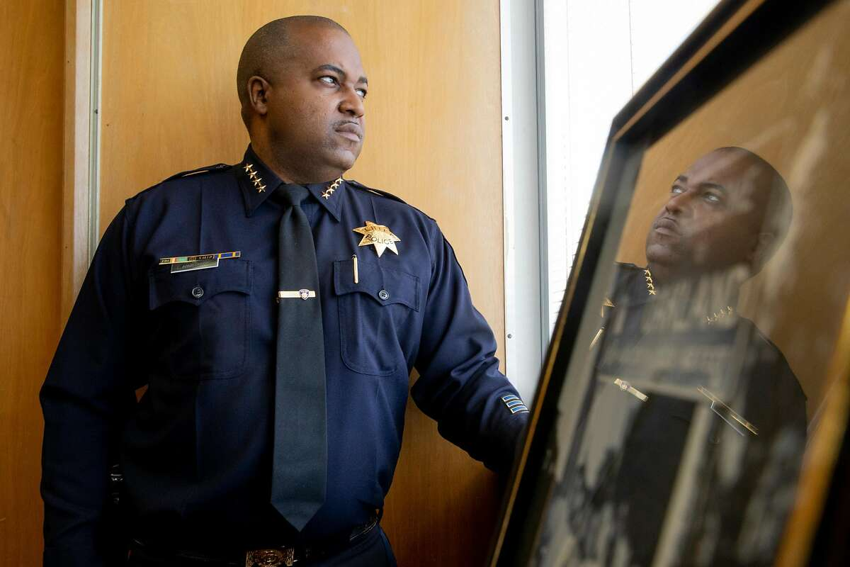 Oakland Police Chief LeRonne Armstrong stands at his office window at the Oakland Police Department Headquarters in downtown Oakland, Calif. Monday, May 24, 2021.