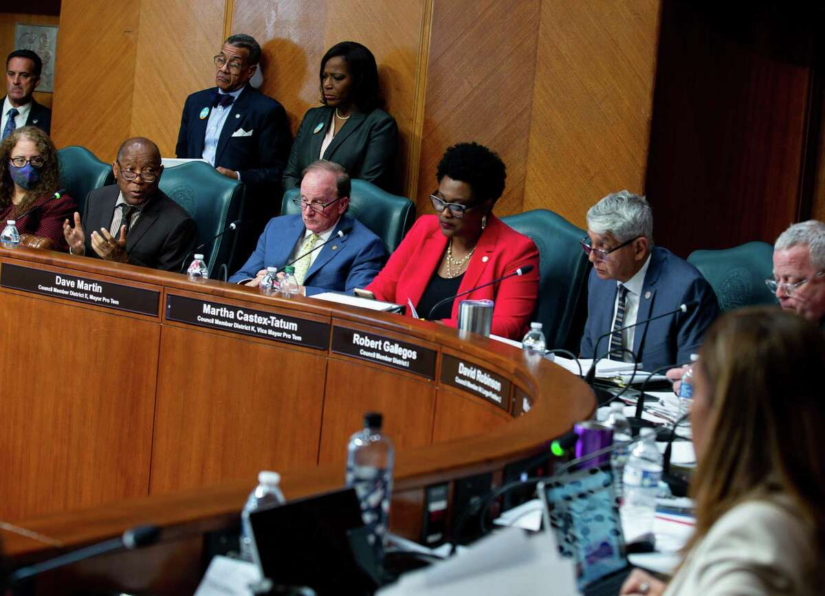 Mayor Sylvester Turner, left, talks to council members during the first in-person meeting in a year at City Hall on Wednesday, June 2, 2021, in Houston. City Council met to consider the mayor's $5.1 billion budget for the next fiscal year.