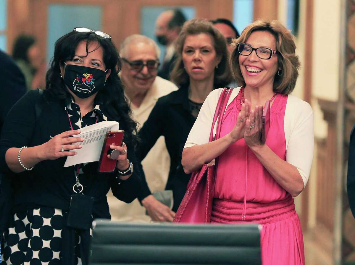 """District 5 Councilwoman Shirley Gonzales (right) claps with joy as she walks into the newly renovated briefing room as City Council meets for the """"B"""" Session meeting in their updated City Hall complex to discuss the allocations for the $326 million in expected federal stimulus dollars on Wednesday, June 2, 2021."""