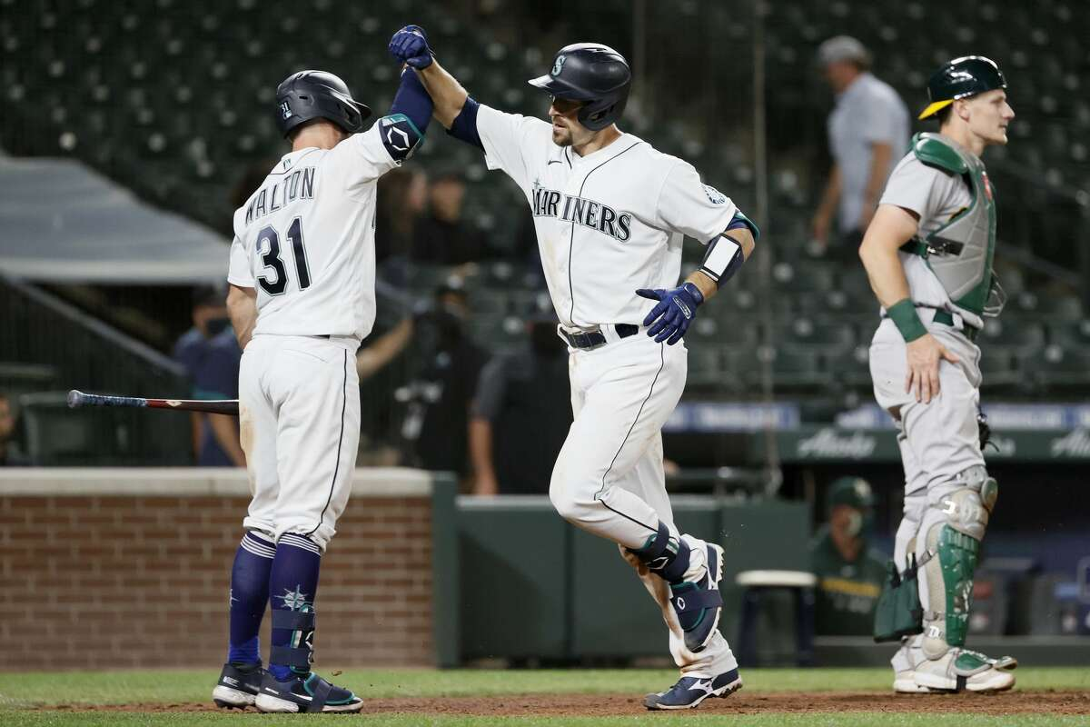 SEATTLE, WASHINGTON - JUNE 01: Donovan Walton #31 and Tom Murphy #2 of the Seattle Mariners celebrate after Murphy's two run home run during the eighth inning against the Oakland Athletics at T-Mobile Park on June 01, 2021 in Seattle, Washington. (Photo by Steph Chambers/Getty Images)