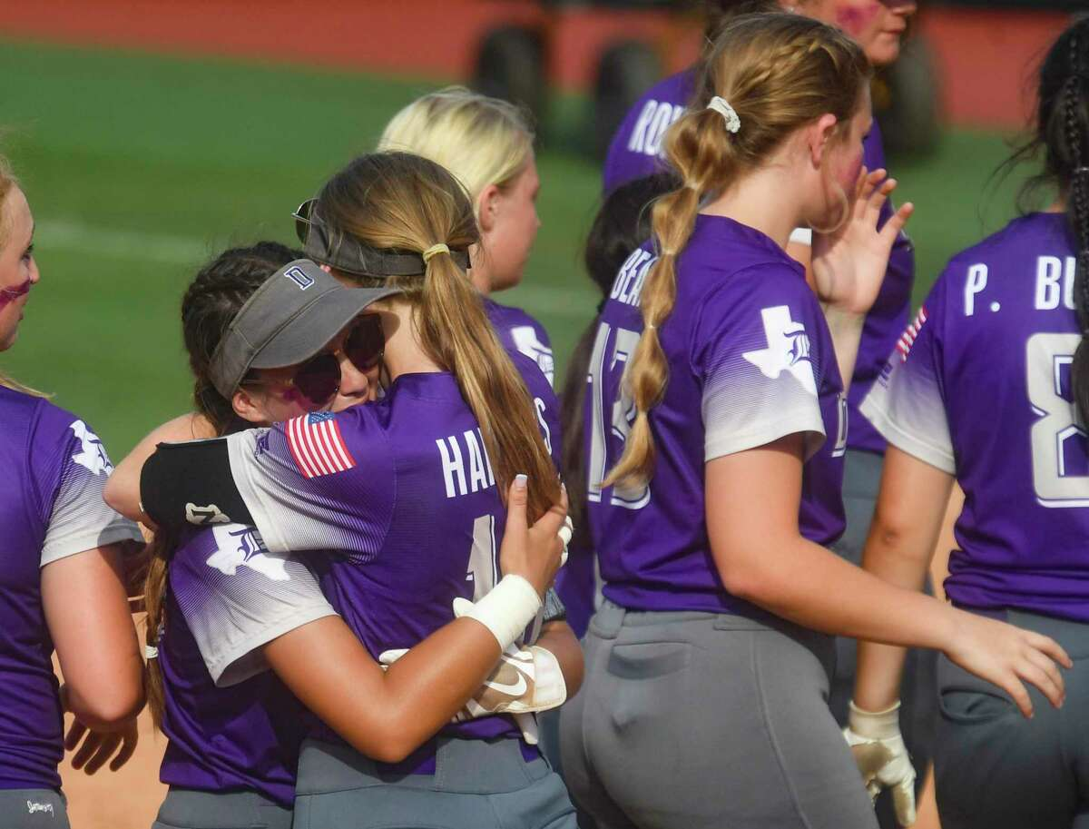 The D'Hanis Cowgirls console one another after dropping the Class 1A softball championship game to Dodd City, 8-4, in Austin on Wednesday, June 2, 2021.