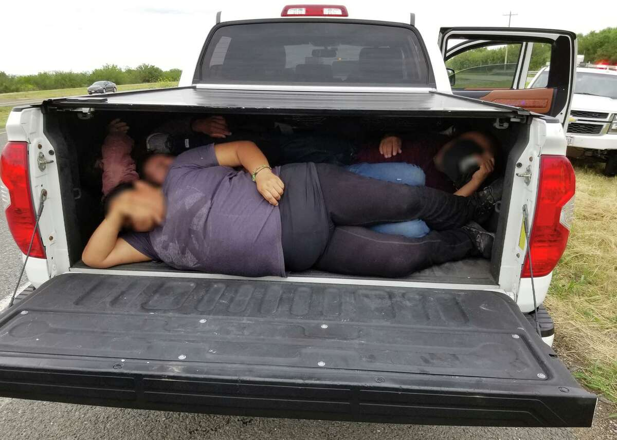 U.S. Border Patrol agents found migrants under the covered bed of a pickup.