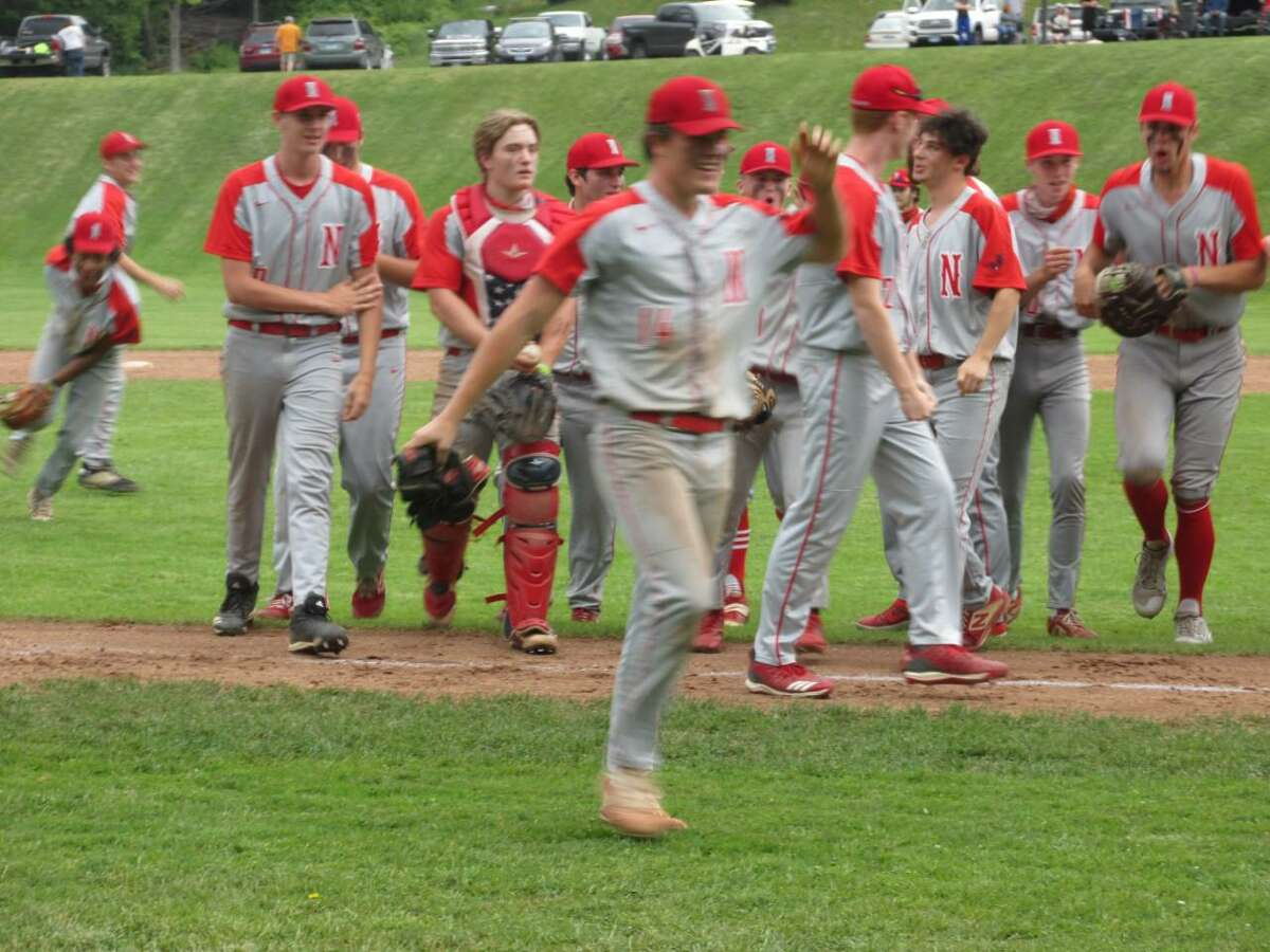 Winning pitcher Josh Hamel leads the Northwestern celebration after a win over Suffield in Class M second round Wednesday afternoon.