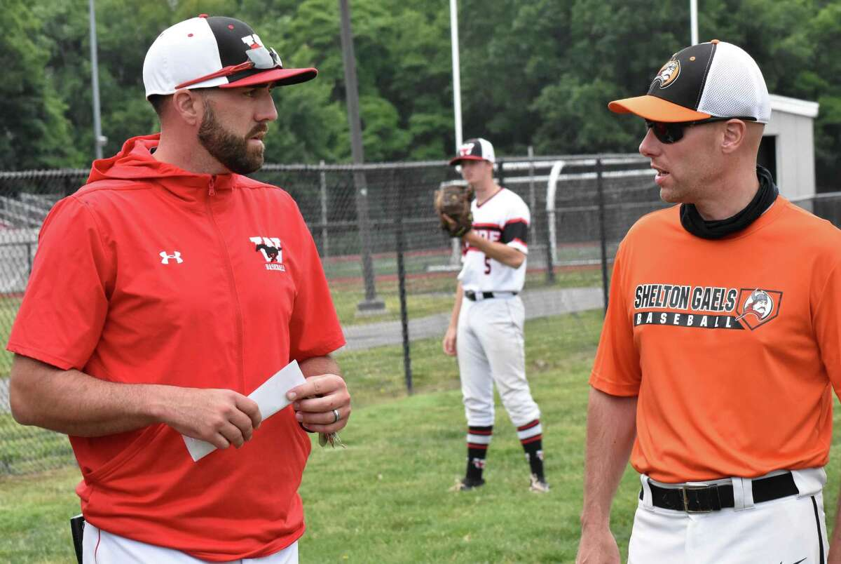 Fairfield Warde coach Brett Conner talks with Shelton coach Scott Gura before the Class LL second round baseball game between Fairfield Warde and Shelton at Fairfield Warde high school on Wednesday, June 2, 2021. Conner played for Guru when he was in middle school and then in high school when Gura was an assistant coach.