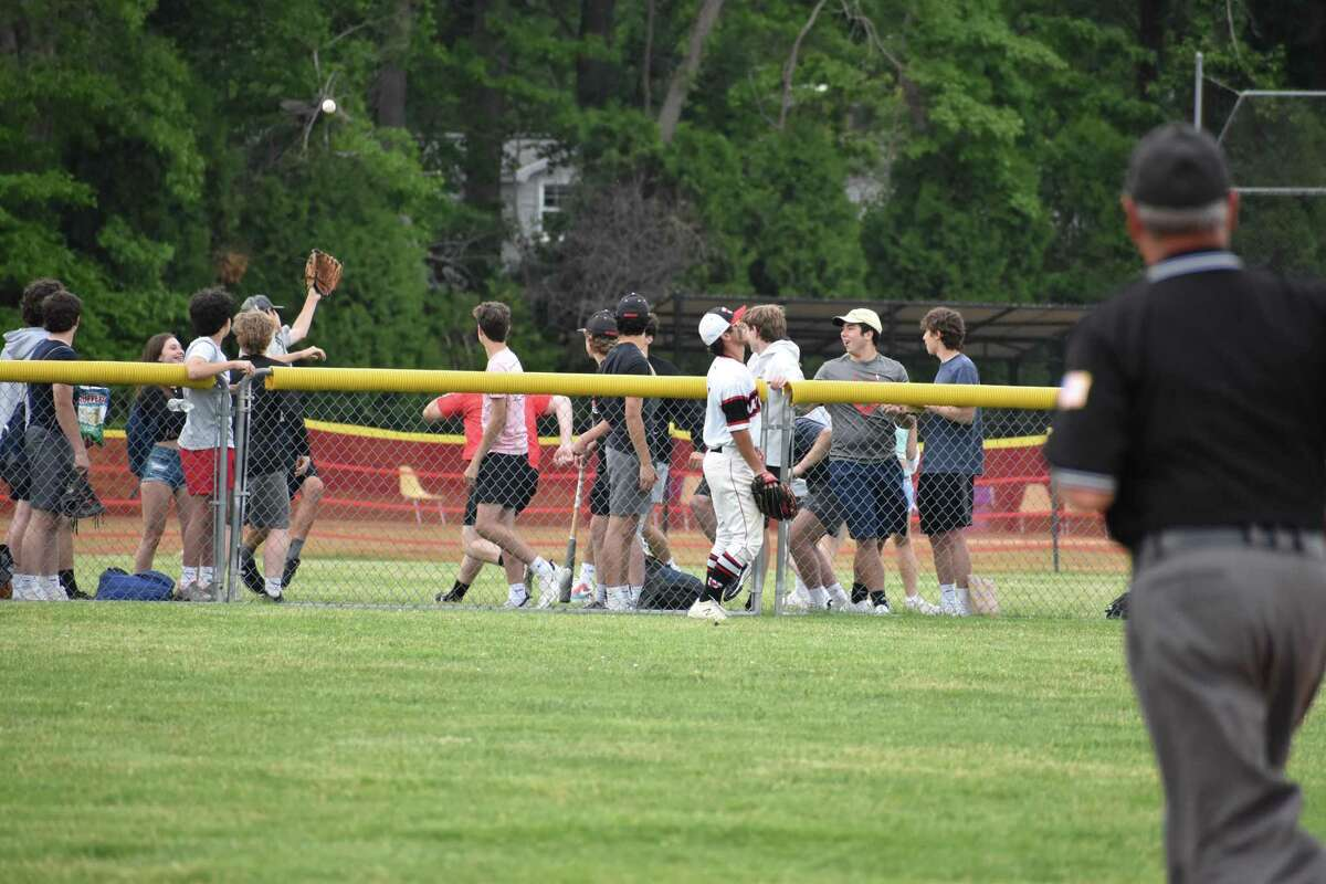 Fairfield Warde left fielder Jake Balogh watches as fans try to catch Shelton's Connor Jensen's home run during the Class LL second round baseball game between Fairfield Warde and Shelton at Fairfield Warde high school on Wednesday, June 2, 2021.