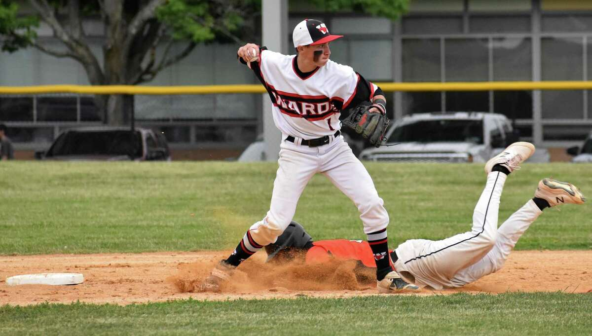 Fairfield Warde's Garrett Larsen throws to first during a Class LL second round baseball game against Shelton on June 2 in Fairfield.