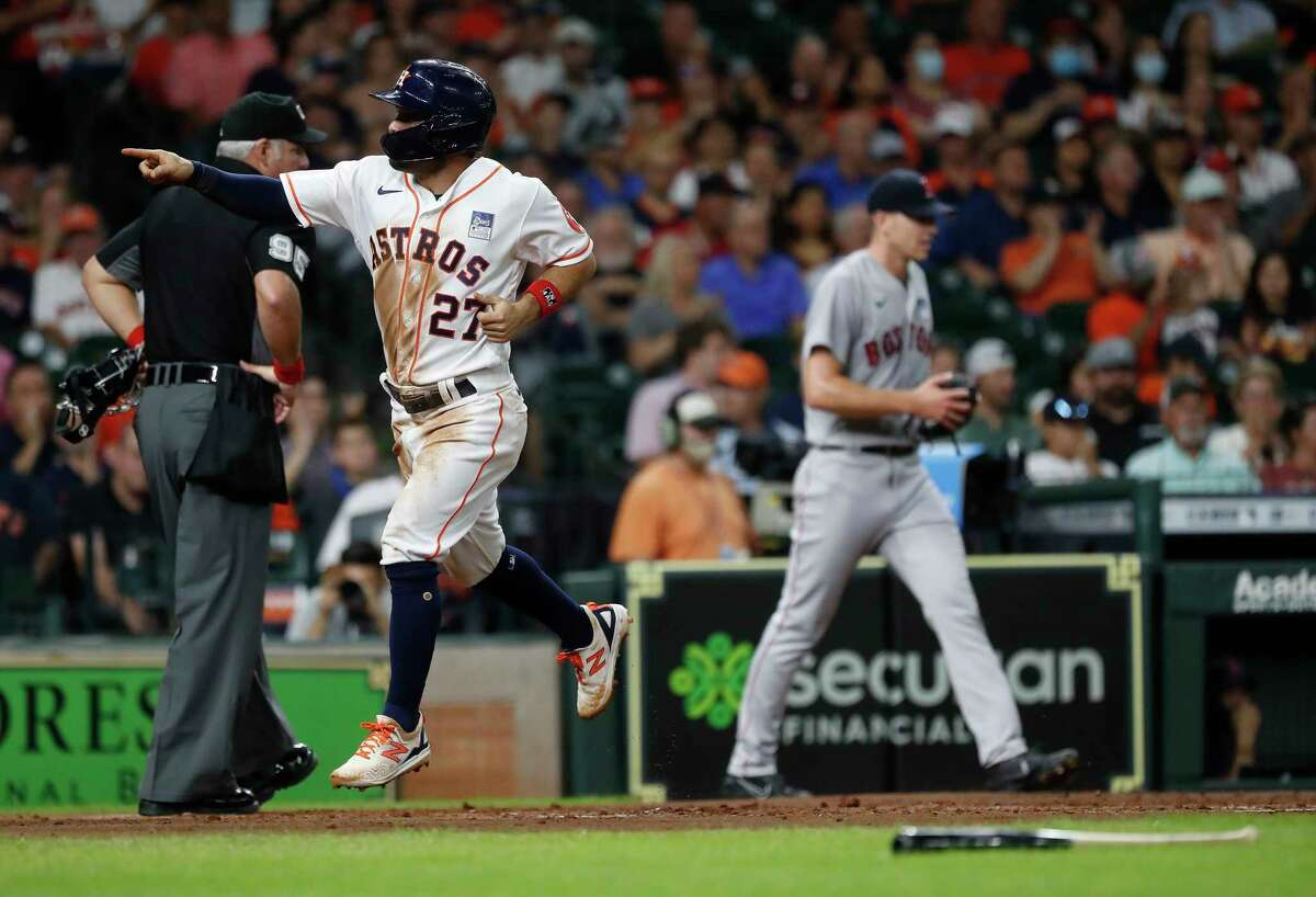 Houston Astros Jose Altuve (27) scores a run on Yuli Gurriel's sacrifice fly during the first inning of an MLB baseball game at Minute Maid Park, Wednesday, June 2, 2021, in Houston.