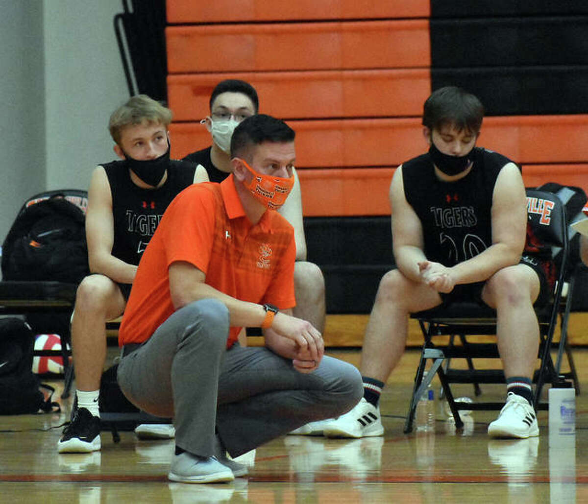 Edwardsville coach Scott Smith watches from the sideline during a match earlier in the season at Lucco-Jackson Gymnasium.