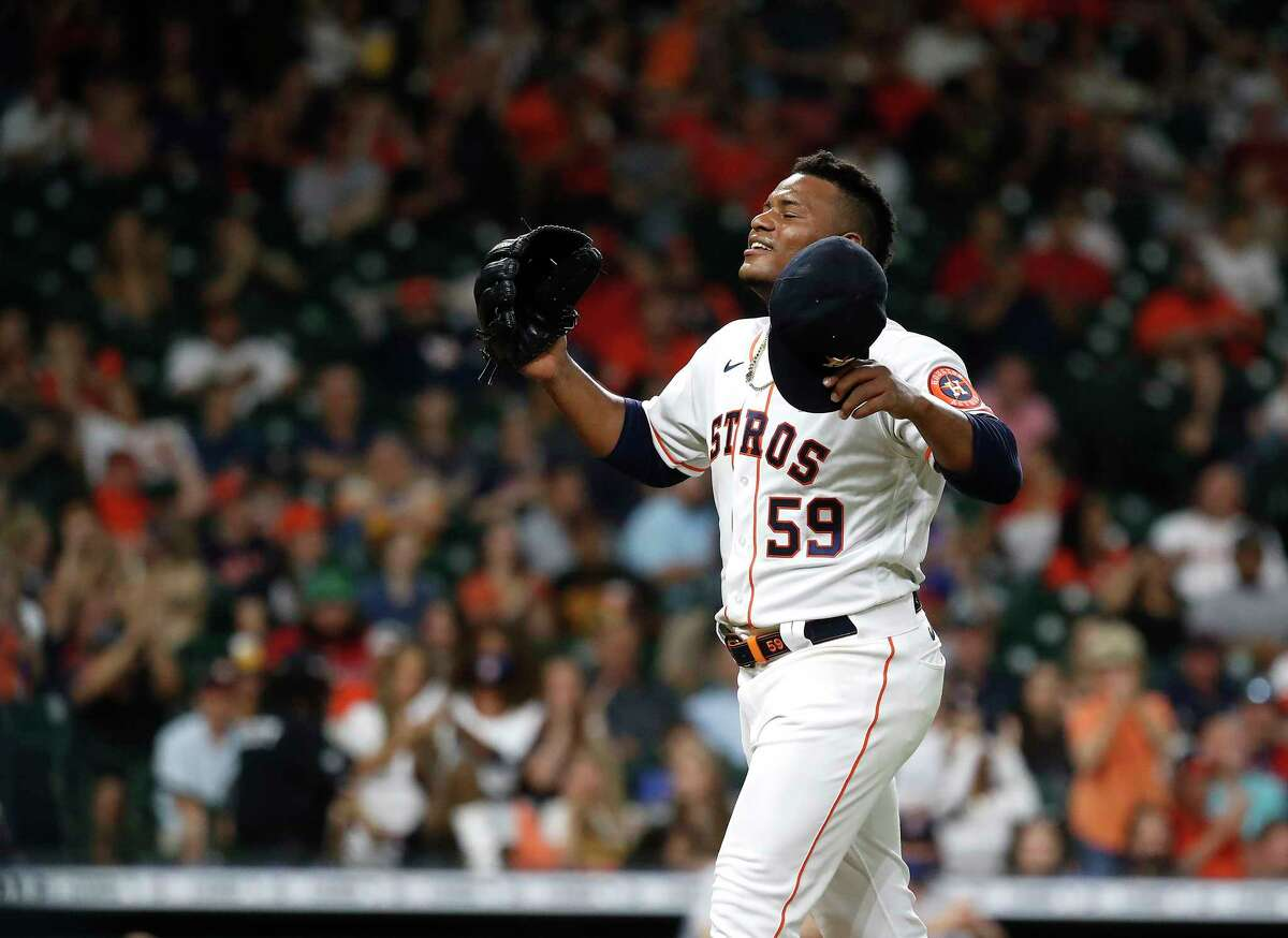 Astros starting pitcher Framber Valdez celebrates after striking out Boston's Enrique Hernandez to end the top of the seventh inning in Houston's 2-1 victory Wednesday night at Minute Maid Park.