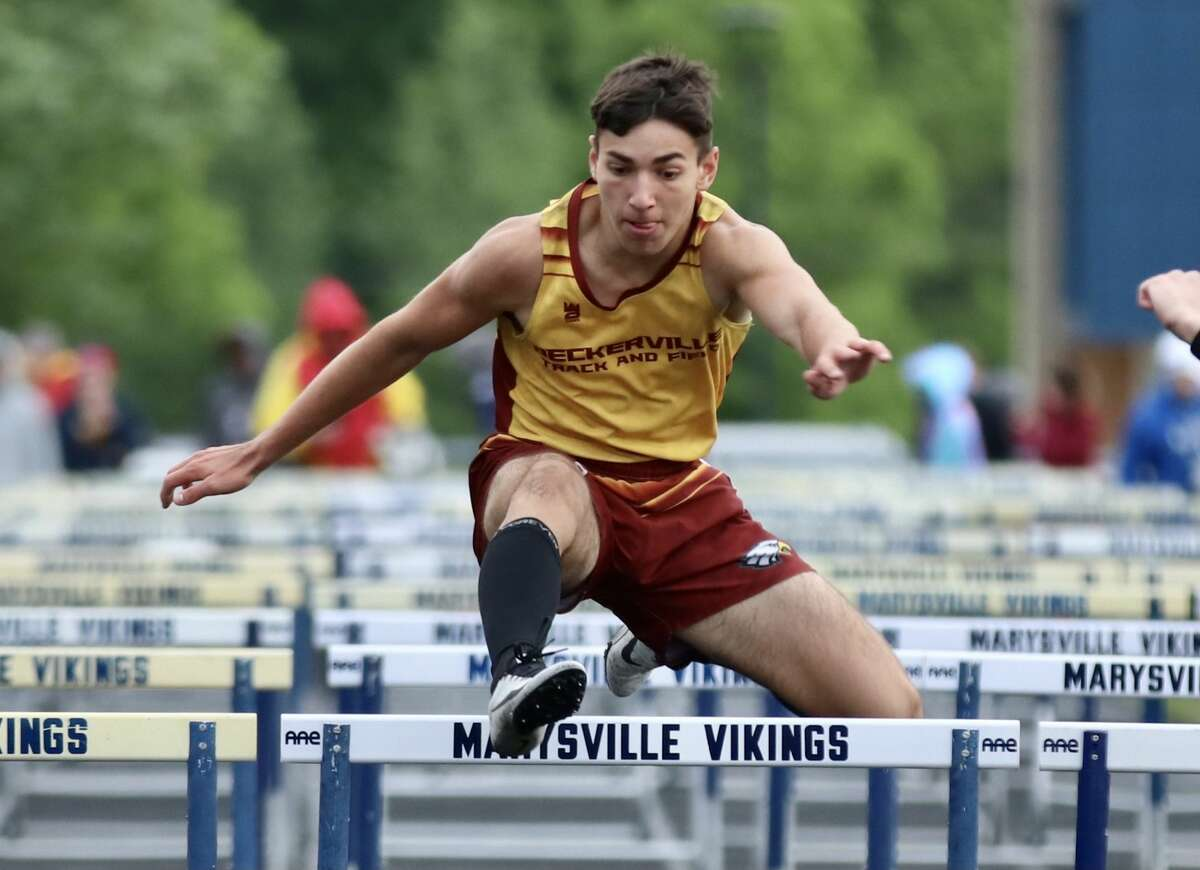 Track teams from Deckerville, harbor Beach competed at the 2021 Blue Water Meet of Champs at Mayville High School on Friday. Above, Deckerville's Will Brown runs in the 110 meter hurdles.