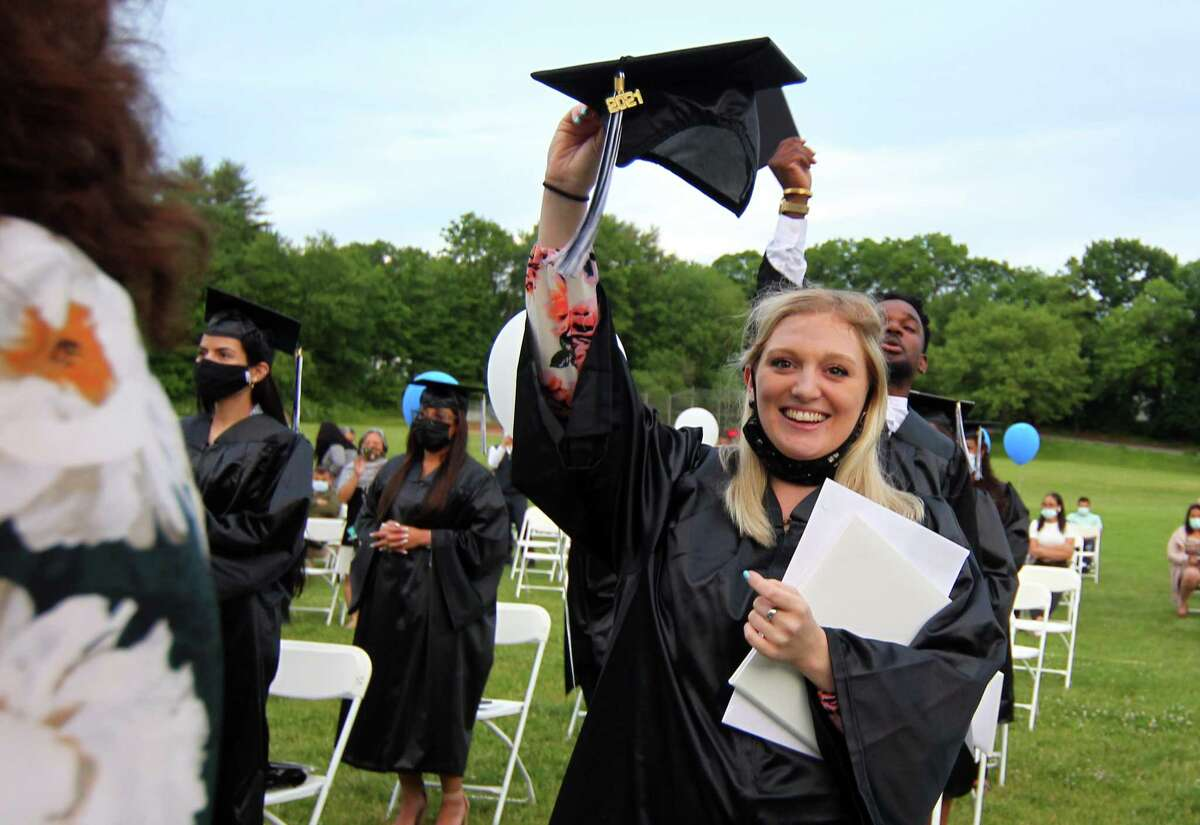 Graduate Jeri Allen celebrates after turing her tassel during Stamford Public Schools Adult & Continuing Education's Class of 2021 Graduation at The Academy of Information Technology & Engineering (AITE) in Stamford, Conn., on Wednesday June 2, 2021.