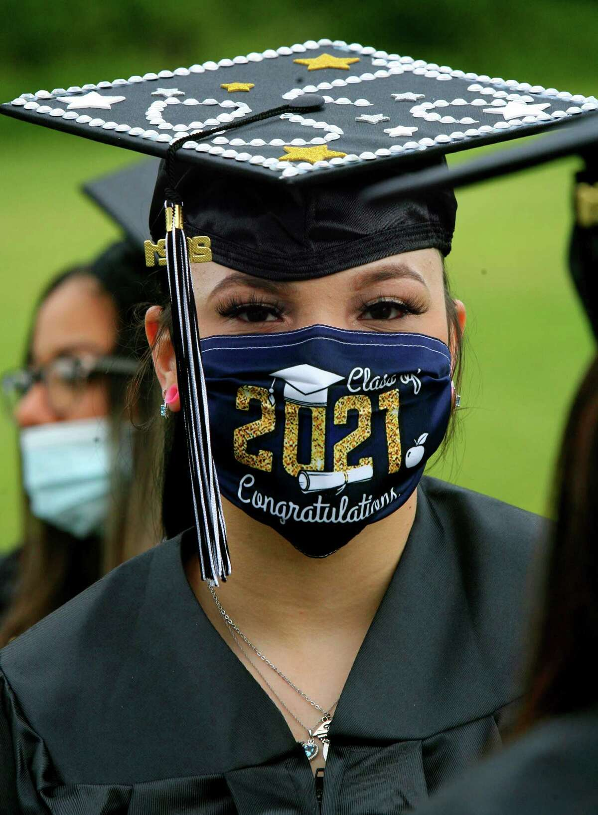 Graduate Breana Montero wears a 2021 mask during Stamford Public Schools Adult & Continuing Education's Class of 2021 Graduation at The Academy of Information Technology & Engineering (AITE) in Stamford, Conn., on Wednesday June 2, 2021.