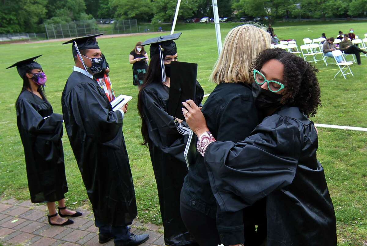 Graduate Alexus Cardillo, at right, hugs her teacher Louise McMinn during Stamford Public Schools Adult & Continuing Education's Class of 2021 Graduation at The Academy of Information Technology & Engineering (AITE) in Stamford, Conn., on Wednesday June 2, 2021.