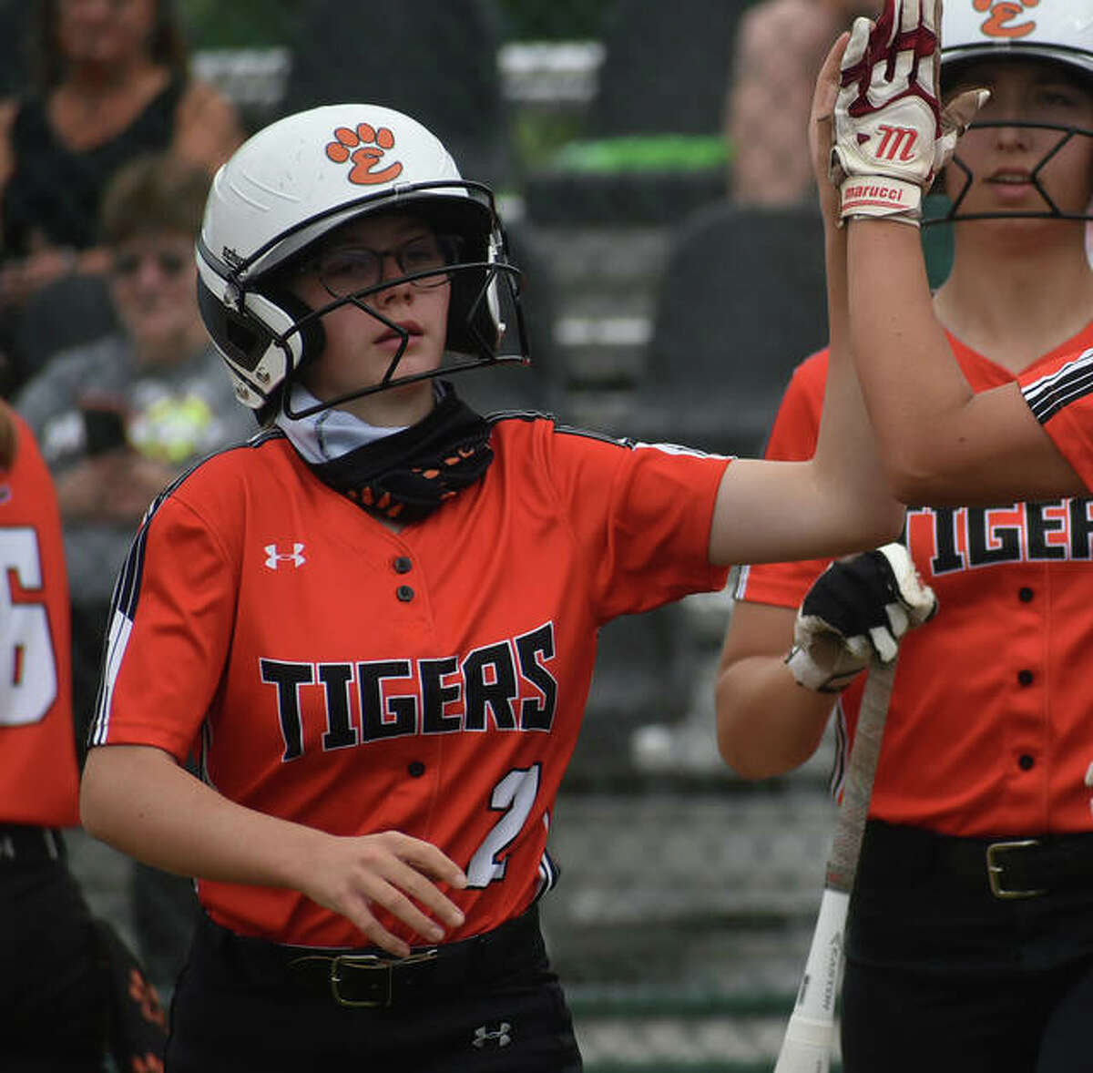 Edwardsville's Grace Blakemore is congratulated by a teammate after scoring in the second inning.
