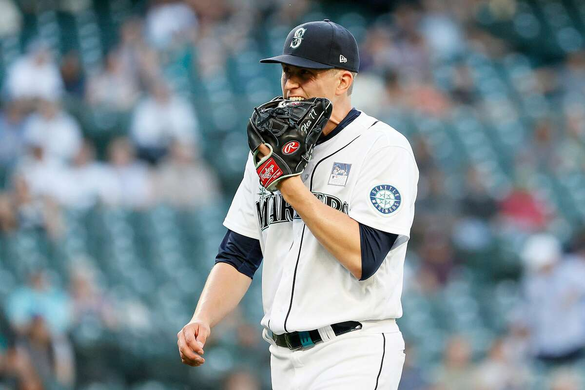 SEATTLE, WASHINGTON - JUNE 02: Chris Flexen #77 of the Seattle Mariners chews his glove after the top of the third inning against the Oakland Athletics during Lou Gehrig Day at T-Mobile Park on June 02, 2021 in Seattle, Washington. (Photo by Steph Chambers/Getty Images)