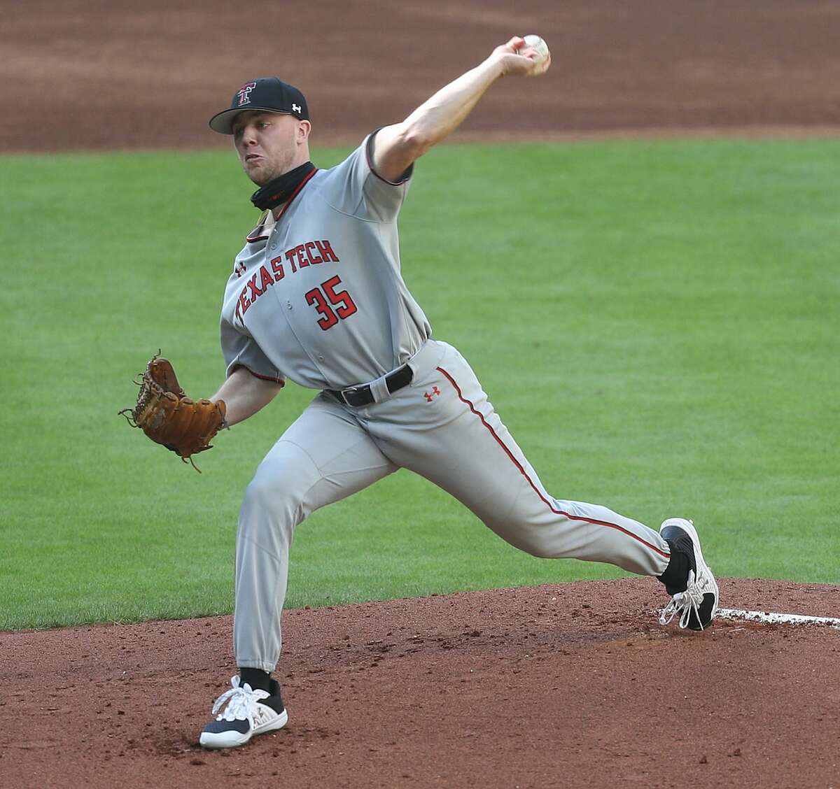 HOUSTON, TEXAS - MARCH 06: Patrick Monteverde #35 of the Texas Tech Red Raiders pitches in the first inning against the Sam Houston State Bearkats at Minute Maid Park on March 06, 2021 in Houston, Texas. (Photo by Bob Levey/Getty Images)