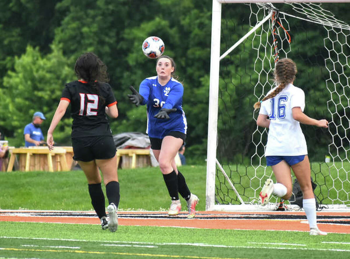 Edwardsville's Kaitlyn Naney makes a save midway through the second half against Quincy.