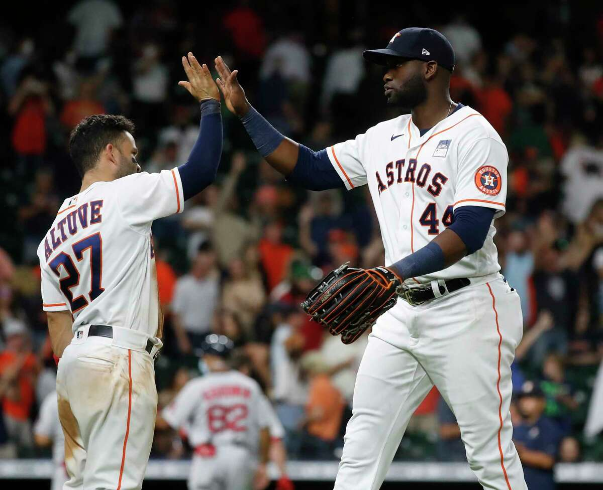 Houston Astros Yordan Alvarez (44) and Jose Altuve celebrate the Astros 2-1 win over the Boston Red Sox during the ninth inning of an MLB baseball game at Minute Maid Park, Wednesday, June 2, 2021, in Houston.